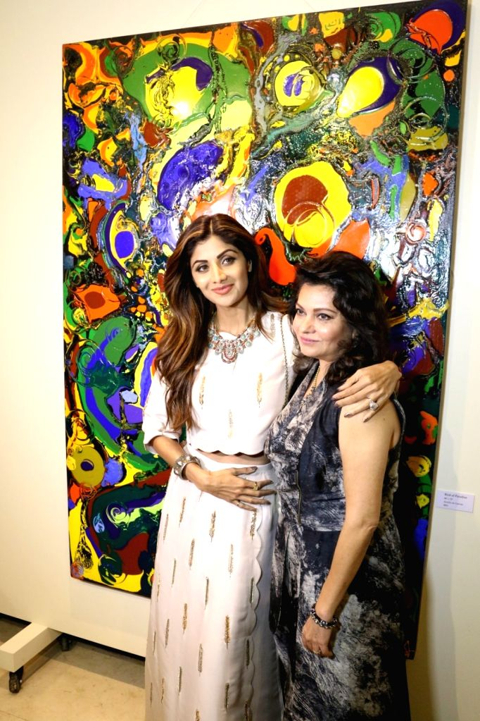 Actress Shilpa Shetty and filmmaker Anu Malhotra during the inauguration of Anu Malhotra`s debut art show Flow Dreams, in Mumbai on Oct 5, 2016. - Shilpa Shetty and Malhotra
