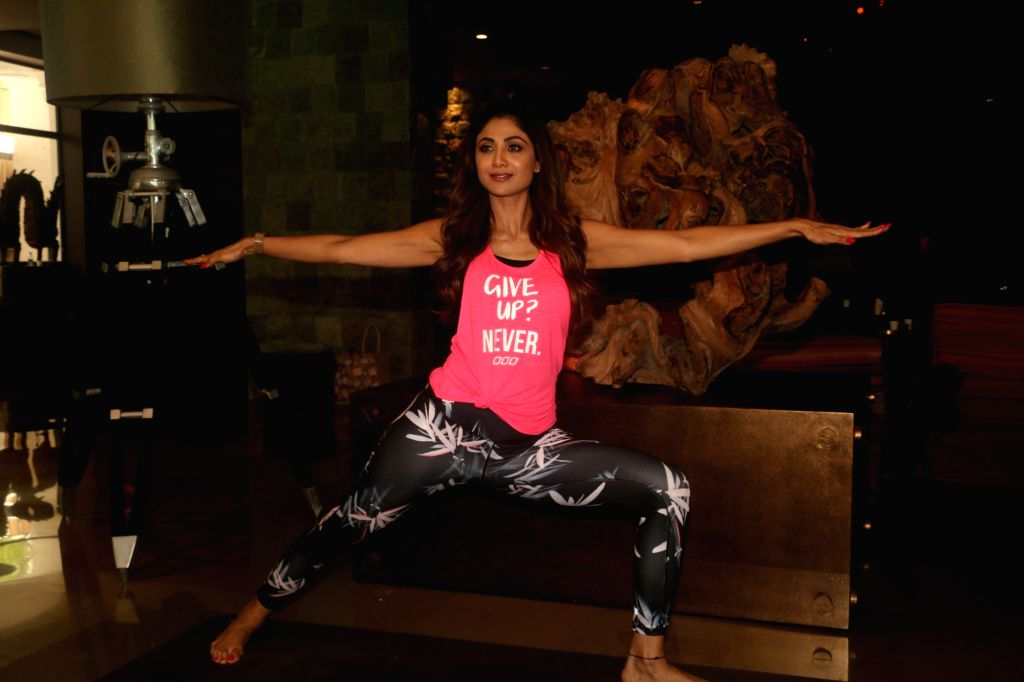 Actress Shilpa Shetty demonstrates a yoga 'asana' -posture- at her residence in Mumbai on June 17, 2019. - Shilpa Shetty