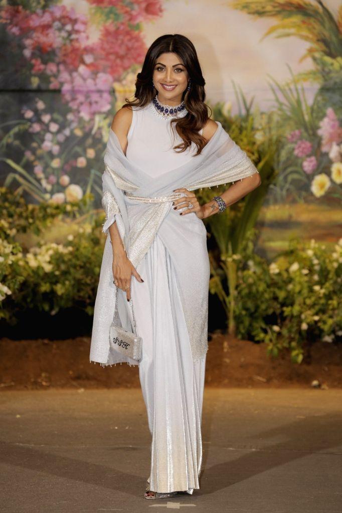 Actress Shilpa Shetty Kundra at the wedding reception of actress Sonam Kapoor and businessman Anand Ahuja in Mumbai on May 8, 2018. - Shilpa Shetty Kundra and Sonam Kapoor
