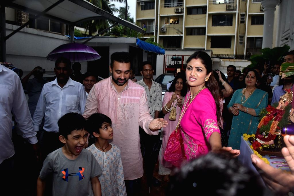 Actress Shilpa Shetty Kundra with her husband Raj Kundra and son Viaan Raj Kundra during Ganesh 'Visarjan' in Mumbai on Sep 3, 2019. - Shilpa Shetty Kundra and Raj Kundra