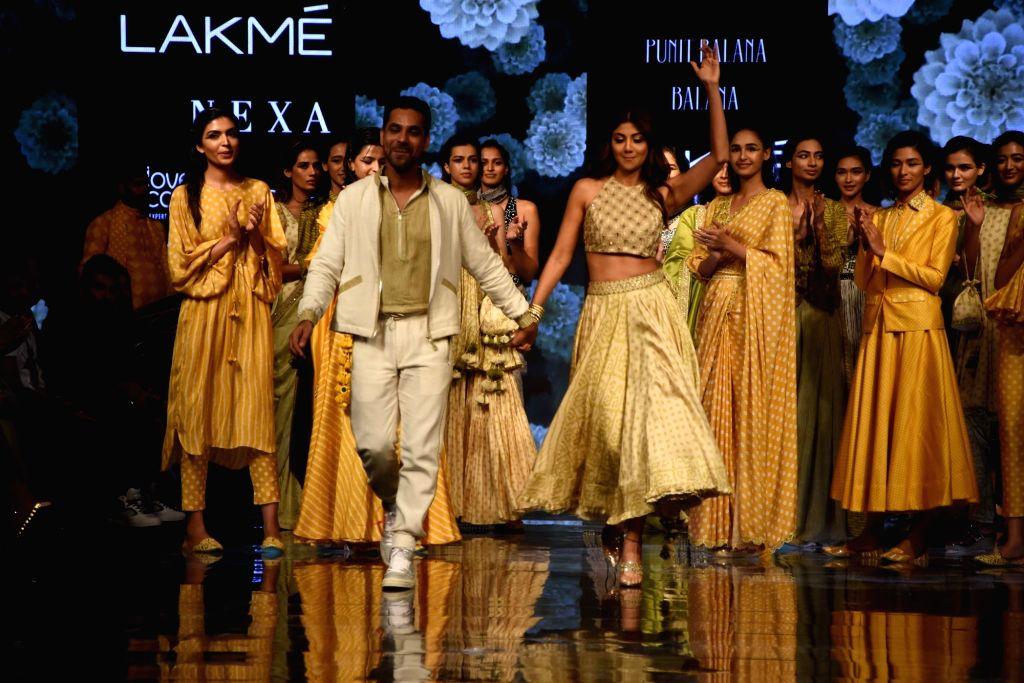 Actress Shilpa Shetty walks the ramp to showcase designer Disha Patil's creations at the Lakme Fashion Week Winter/Festive 2019 in Mumbai on Aug 25, 2019. - Shilpa Shetty and Disha Patil