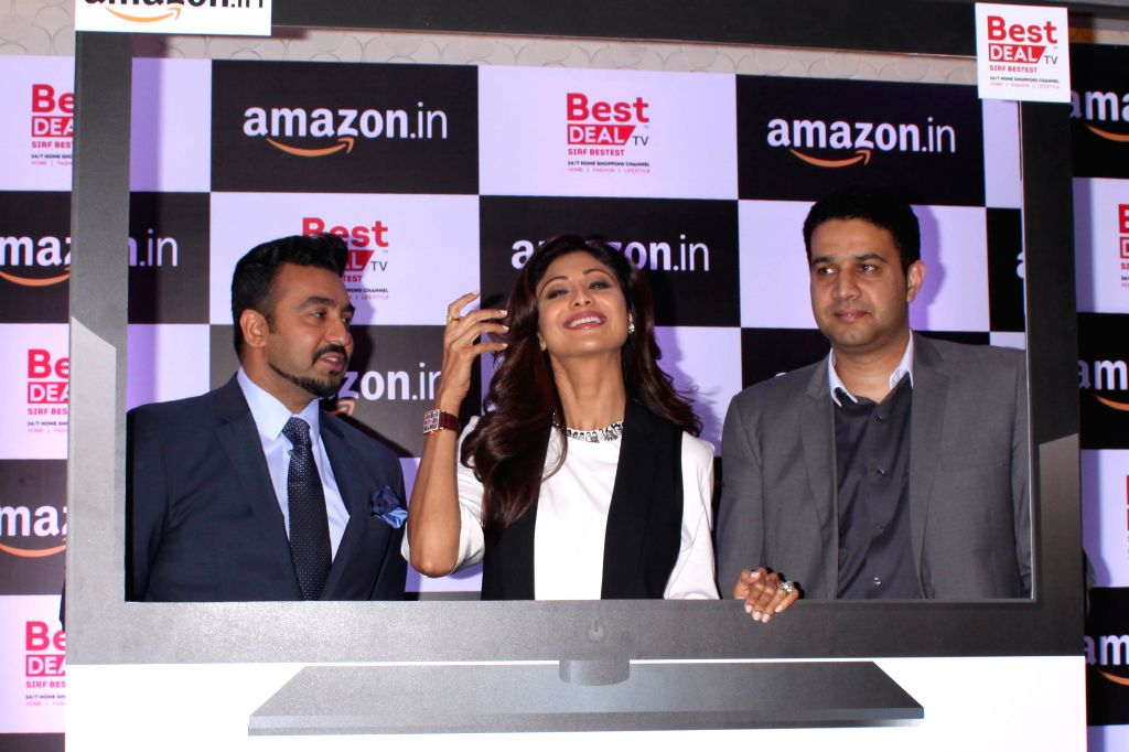 Actress Shilpa Shetty with her husband Raj Kundra during the launch of celebrity-endorsed products of Best Deal TV exclusively on Amazon, in New Delhi on June 24, 2015. - Raj Kundra