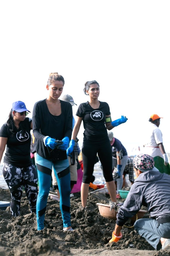 Actress-singer Anusha Dandekar participate in the Adidas beach cleaning movement at Versova Jetty Beach in Mumbai's Juhu on May 20, 2018.