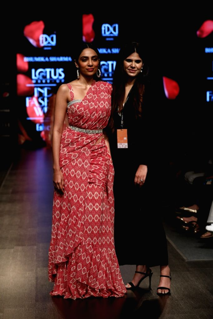 Actress Sobhita Dhulipala and fashion designer Bhumika Sharma on the third day of Lotus Make-up India Fashion Week, in New Delhi on Oct 11, 2019. - Sobhita Dhulipala and Bhumika Sharma