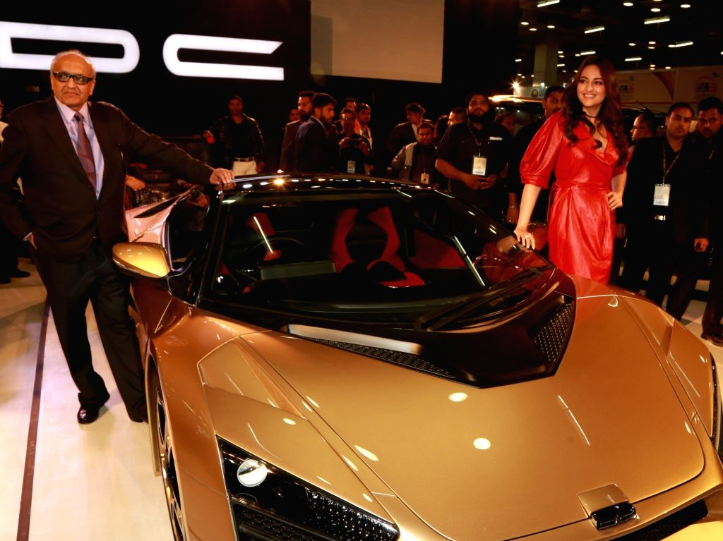 Actress Sonakshi Sinha and DC Design Pvt Ltd Chairman and MD Dilip Chhabria unveil 'DC TCA' at the Auto Expo 2018 in New Delhi on Feb 8, 2018. - Sonakshi Sinha and Dilip Chhabria