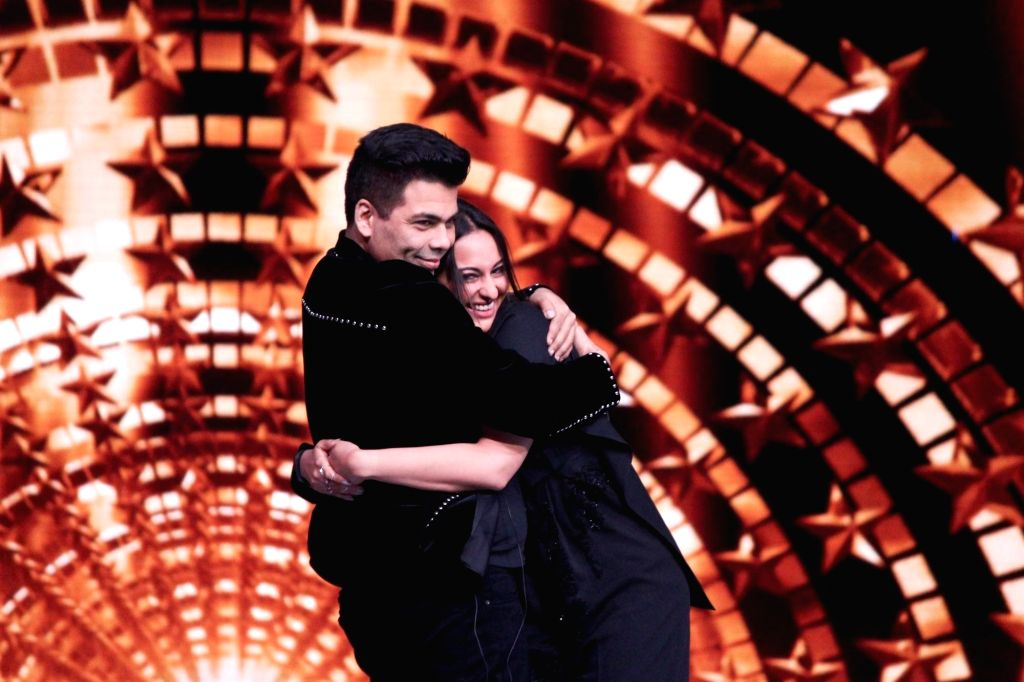 "Actress Sonakshi Sinha and filmmaker Karan Johar hug each other on the sets of reality show ""India's Next Superstars"" in Mumbai on Feb 15, 2018. - Sonakshi Sinha and Karan Johar"