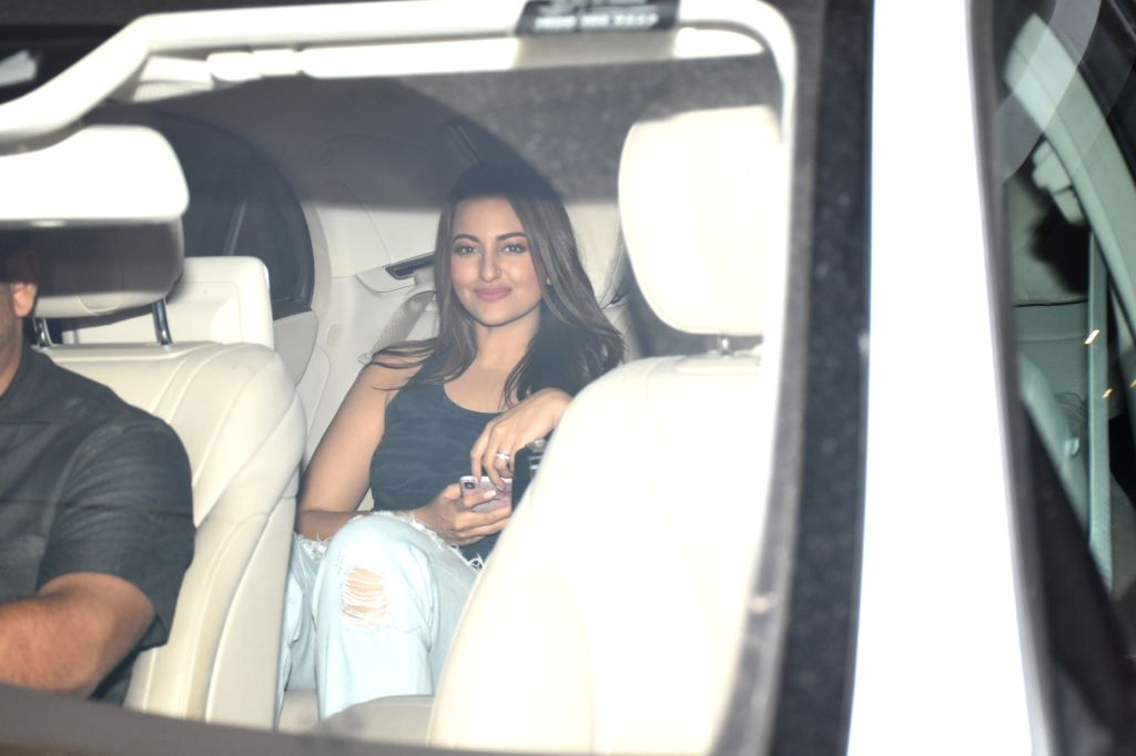 Actress Sonakshi Sinha arrives at filmmaker Karan Johar's house party, in Mumbai on June 12, 2019. - Sonakshi Sinha