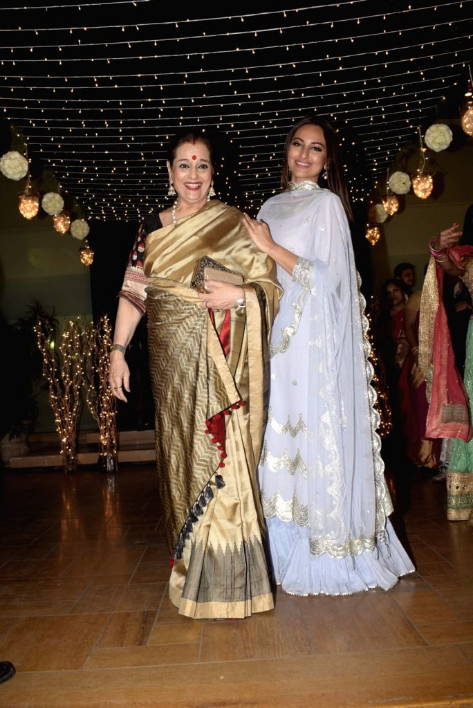 Actress Sonakshi Sinha with her mother Poonam Sinha at her friend's wedding reception in Mumbai, on Feb 16, 2019. - Sonakshi Sinha and Poonam Sinha