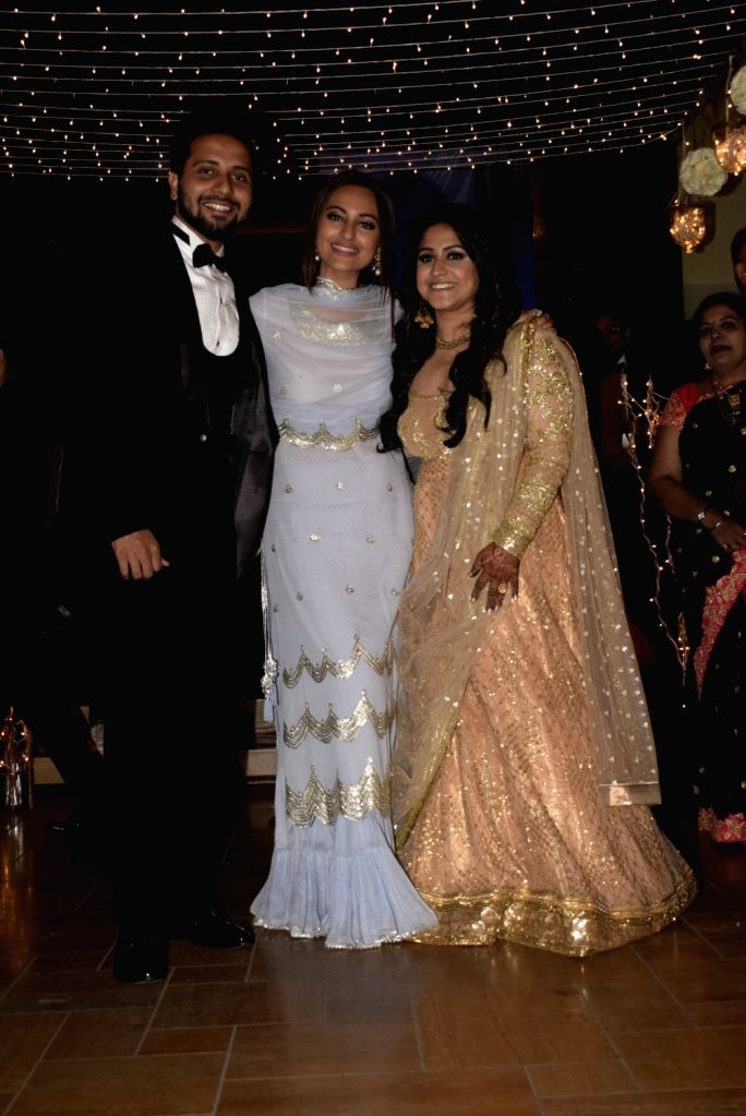 Actress Sonakshi Sinha with the newlywed couple at their wedding reception in Mumbai, on Feb 16, 2019. - Sonakshi Sinha