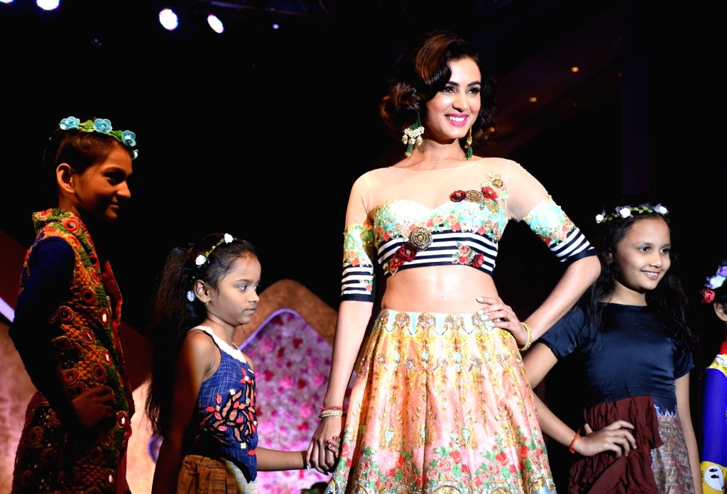 """Actress Sonal Chauhan walks the ramp during """"Ramp for Champs"""" - a programme organised to support girl child empowerment through education in Mumbai. - Sonal Chauhan"""