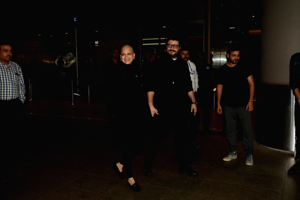 Actress Sonali Bendre Behl accompanied by her film producer husband Goldie Behl, arrives at Chhatrapati Shivaji International Airport months after she left for New York to seek treatment of a ... - Sonali Bendre Behl
