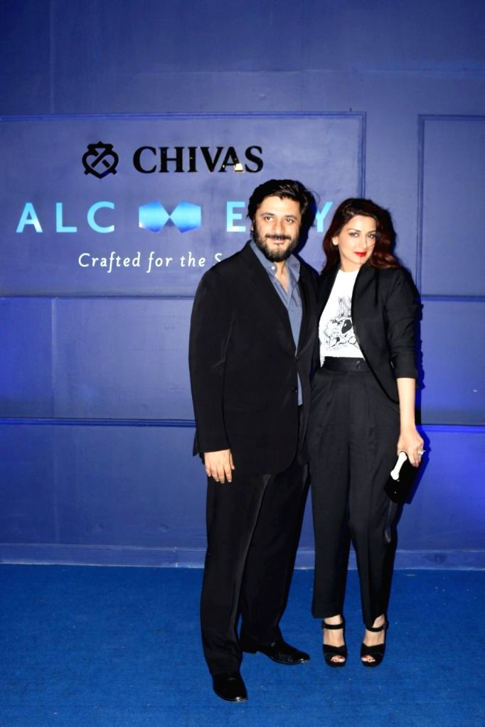 Actress Sonali Bendre with her husband Goldie Behl during the Chivas 18 Alchemy event in Mumbai on March 25, 2017. - Sonali Bendre