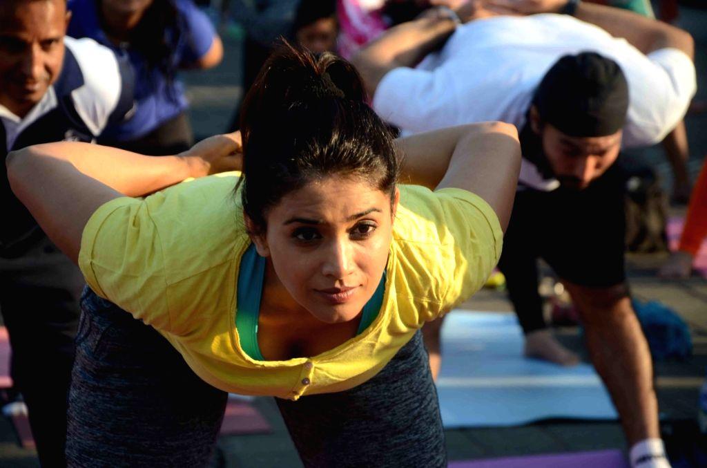 "Actress Sonali Kulkarni participates in ""Yoga by the Bay"" at Marine Drive in Mumbai on Nov 27, 2016. - Sonali Kulkarni"