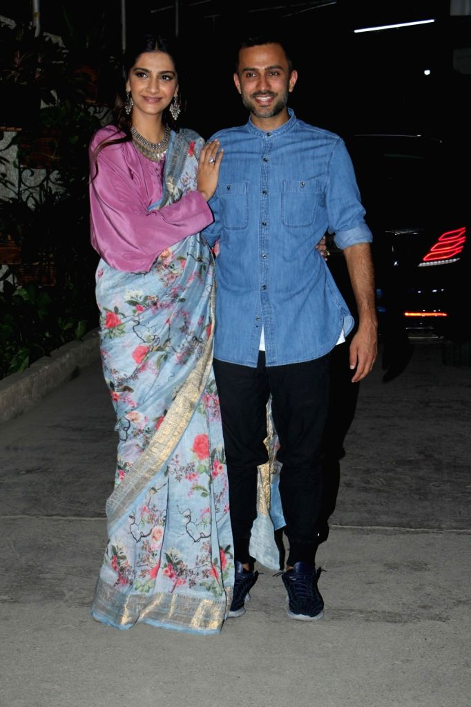 "Actress Sonam Kapoor along with her Anand Ahuja arrive at the screening of the film ""Bhavesh Joshi Superhero"" in Mumbai on May 31, 2018. - Sonam Kapoor and Bhavesh Joshi Superhero"