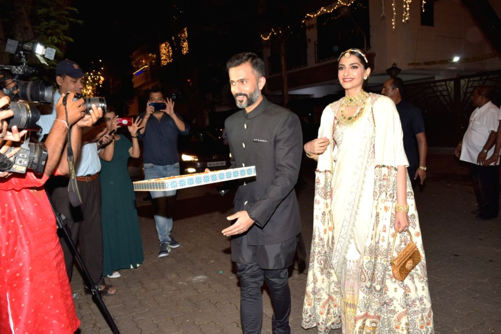Actress Sonam Kapoor and her husband Anand Ahuja distribute sweets among media personnel at a Diwali bash hosted by her father Anil Kapoor in Mumbai on Oct 27, 2019. - Sonam Kapoor