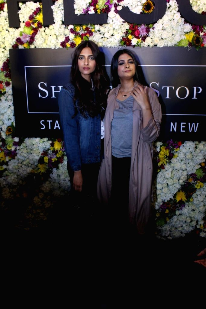Actress Sonam Kapoor with her sister and filmmaker Rhea Kapoor during the launch of Rheson, a clothing brand in Mumbai on May 12, 2017. - Sonam Kapoor