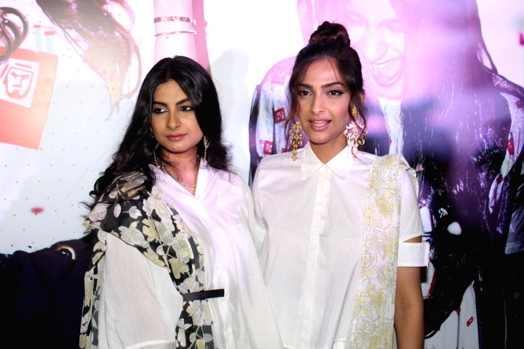 Actress Sonam Kapoor with her sister and filmmaker Rhea Kapoor during the showcase of clothing brand Rheson in Mumbai on May 16, 2017. - Sonam Kapoor