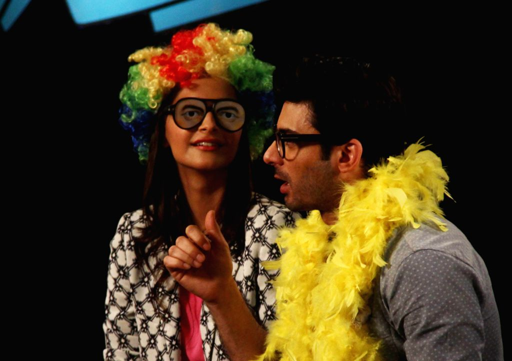 Actress Sonam Kapoor with Pakistani actor Fawad Khan on sets of Disney Show Captain Tiao, during the promotion of their upcoming film Khoobsurat in Mumbai, on Aug. 24, 2014. - Sonam Kapoor