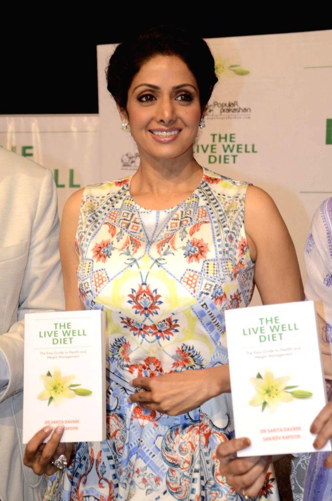 Actress Sridevi with Author Dr Sarita Davar launched the book  ``Live Well Diet`` alongwith chef Sanjeev Kapoor, singer Hariharan, photographer Avinash Govarikar, Sharmila Thackeray, wife of MNS ... - Sanjeev Kapoor