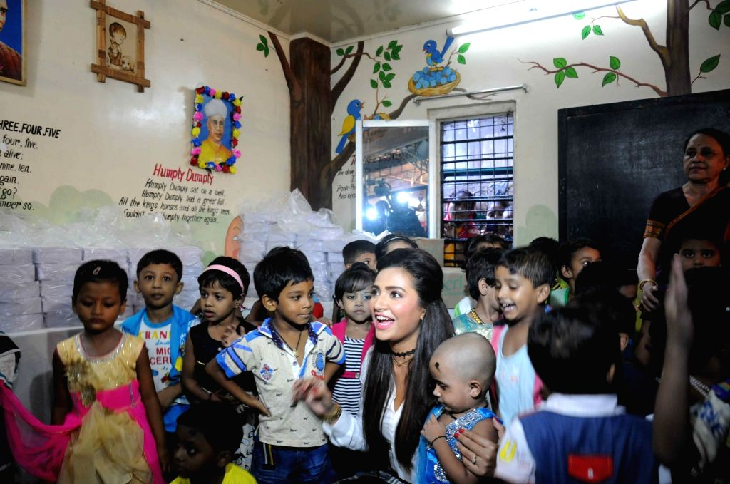 Actress Subhasree Ganguly meets underprivileged children on the occasion of International Literacy Day celebration in Kolkata on Sept 8, 2016. - Subhasree Ganguly