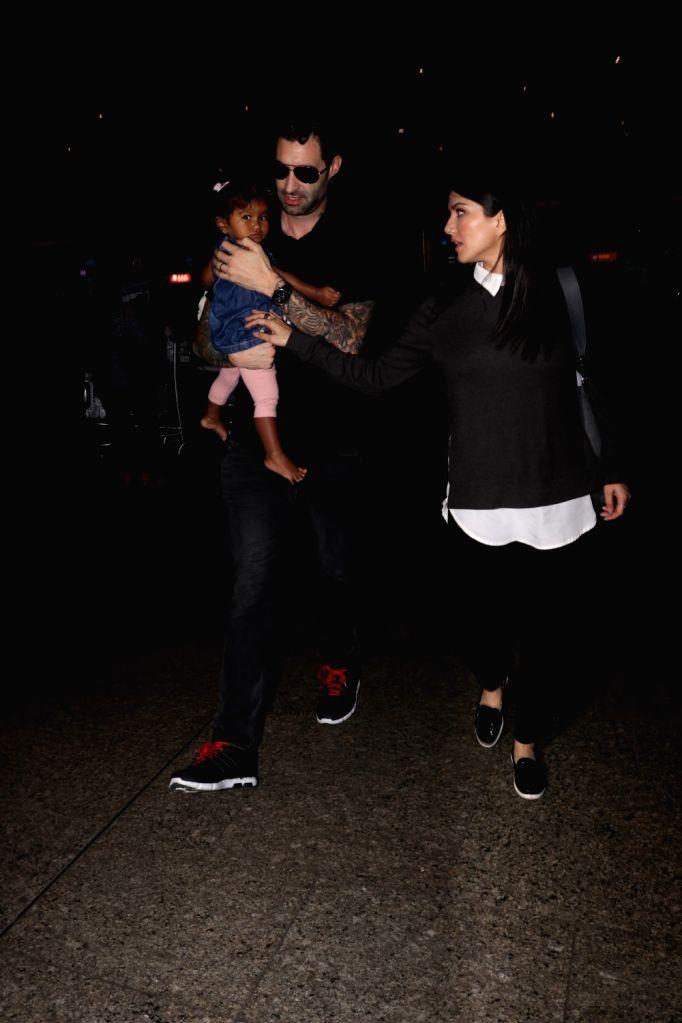 Actress Sunnny Leone along with her husband Daniel Weber and daughter Nisha Kaur Weber at Chhatrapati Shivaji Maharaj International airport  in Mumbai on Sept 12, 2017. - Sunnny Leone and Nisha Kaur Weber