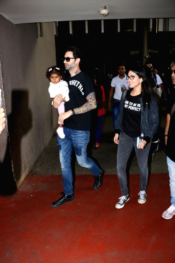 Actress Sunnny Leone along with her husband Daniel Weber and daughter Nisha Kaur Weber at Chhatrapati Shivaji Maharaj International airport in Mumbai on Sept 18, 2017. - Sunnny Leone and Nisha Kaur Weber