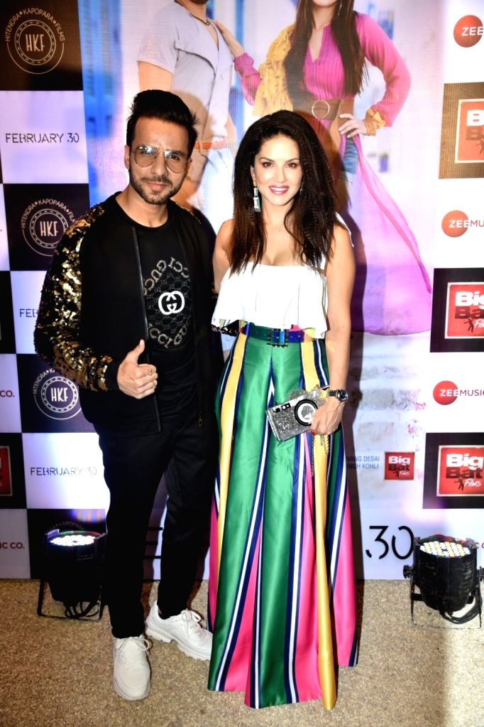 """Actress Sunny Leone along with Upesh Jangwal at the song launch of """"Hollywood Wale Nakhre"""" in Mumbai, on Feb 15, 2019. - Sunny Leone"""