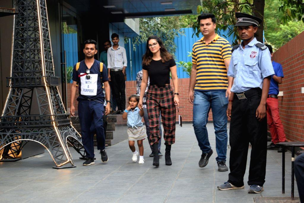 Actress Sunny Leone and her daughter Nisha Kaur Weber seen at Juhu in Mumbai, on July 18, 2019. - Sunny Leone and Nisha Kaur Weber