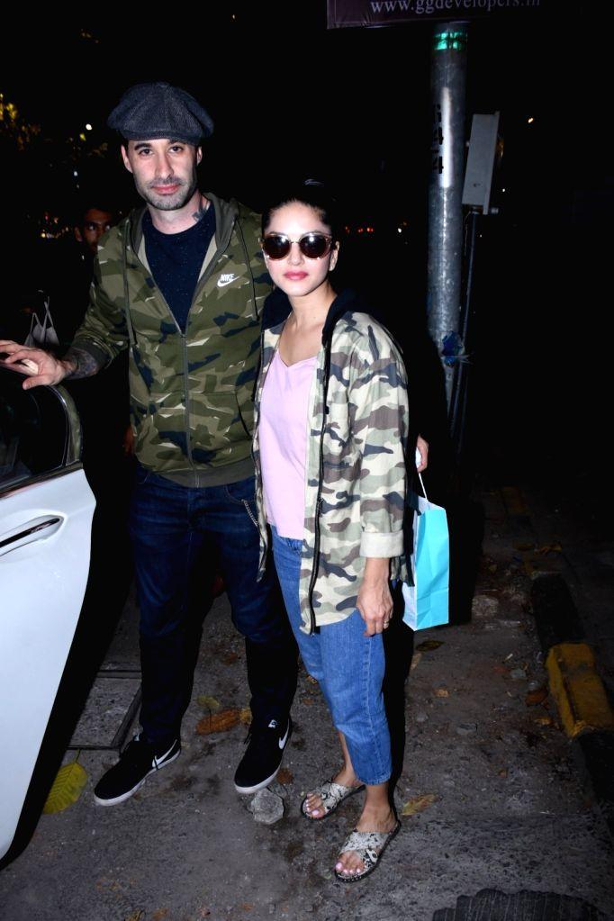 Actress Sunny Leone and her husband Daniel Weber seen at Bandra, in Mumbai on Nov 27, 2019. - Sunny Leone