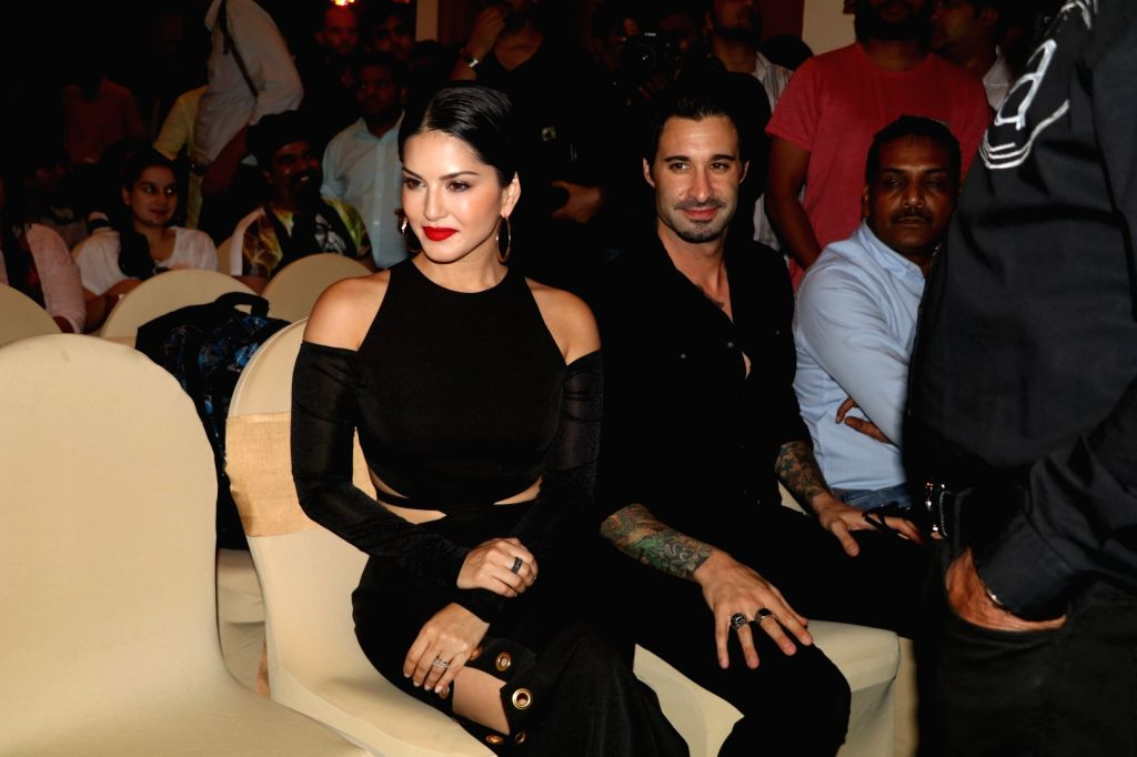 Actress Sunny Leone and husband Daniel Weber during the launch of Manforce special calendar, in Mumbai on July 11, 2016. - Sunny Leone