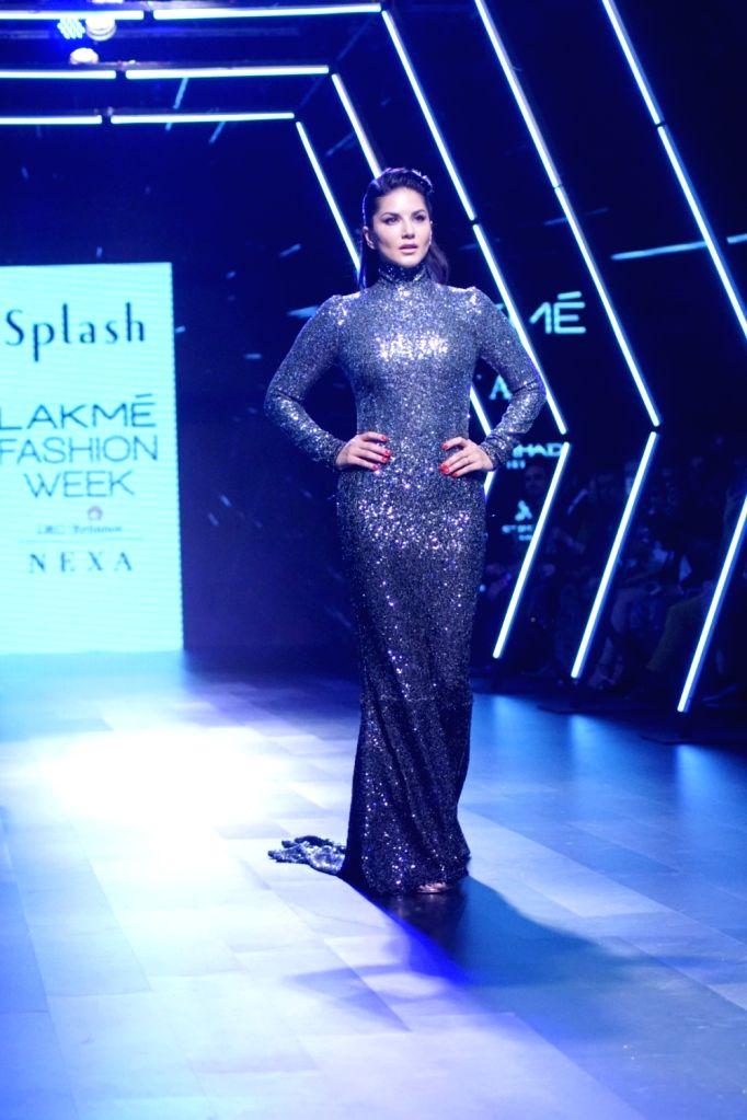 Actress Sunny Leone displays the creation of Fashion company Splash during the Lakme Fashion Week Winter/Festive 2017 in Mumbai on Aug 20, 2017. - Sunny Leone