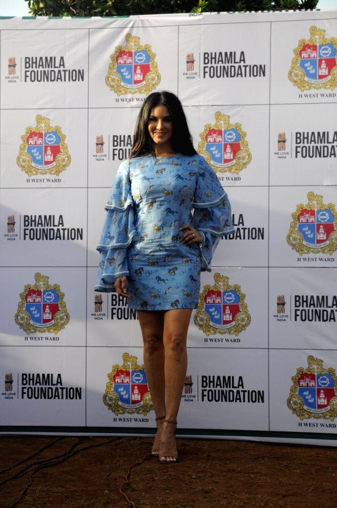 Actress Sunny Leone during the tree plantation drive organised by Municipal Corporation of Greater Mumbai (MCGM) and Bhamla foundation in Mumbai, on May 23, 2017. - Sunny Leone