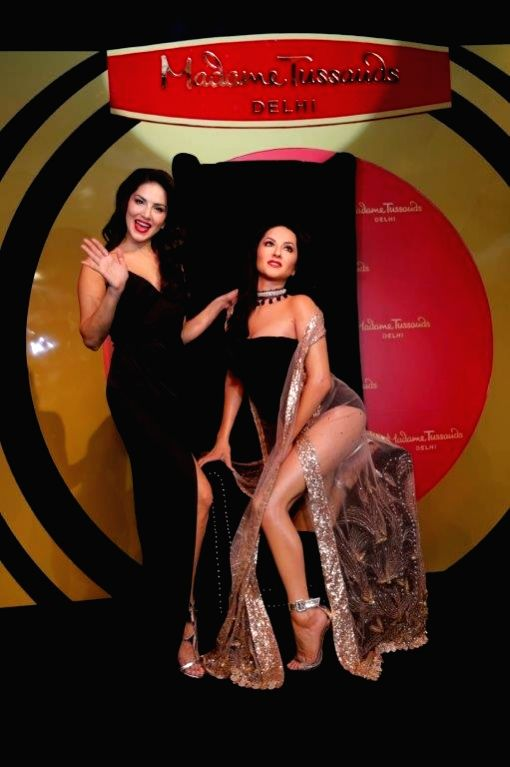 Actress Sunny Leone poses with her wax statue at Madame Tussauds in New Delhi on Sept 18, 2018. - Sunny Leone