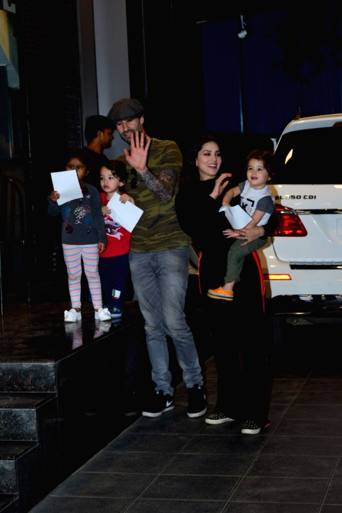Actress Sunny Leone seen with her husband Daniel Weber and children Nisha Kaur Weber, Noah Singh Weber and Asher Singh Weber, at Juhu in Mumbai on March 14, 2020. - Sunny Leone, Nisha Kaur Weber and Asher Singh Weber