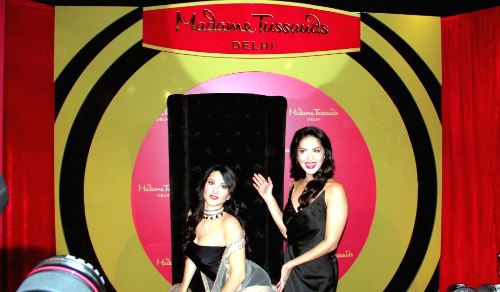 Actress Sunny Leone with her wax statue that was unveiled at the Madame Tussauds museum in New Delhi on Sept 18, 2018. - Sunny Leone