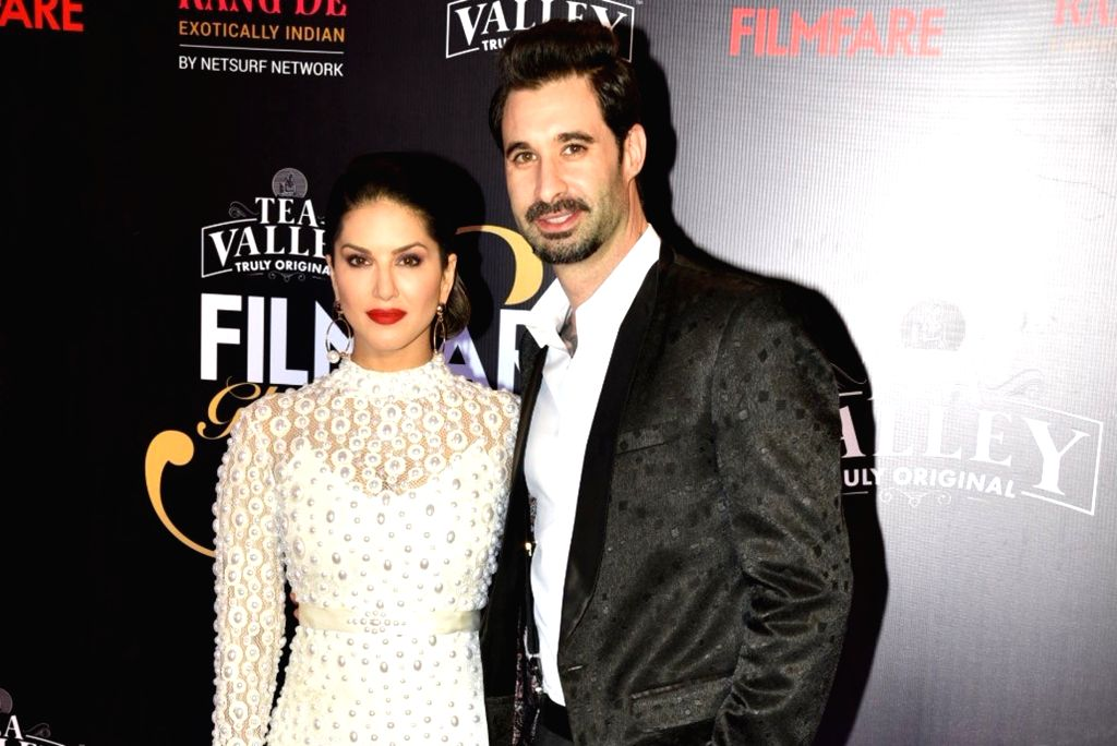 Actress Sunny Leone and Daniel Weber on the red carpet of Filmfare Glamour And Style Awards 2019, in Mumbai on Feb 11, 2019. - Sunny Leone