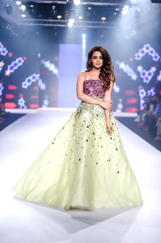 Actress Surveen Chawla walks the ramp showcasing designers Karl and Leo's creation on the second day of Bombay Times Fashion Week 2018, in Mumbai on March 31, 2018. - Surveen Chawla