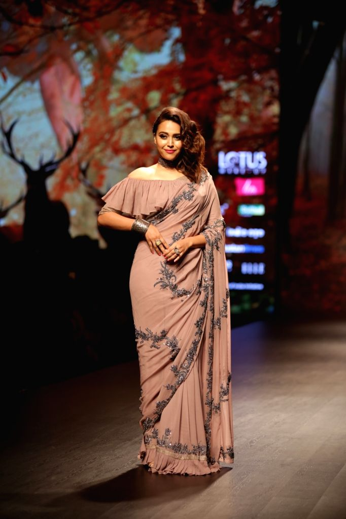 Actress Swara Bhaskar walks the ramp showcasing fashion designer Prreeti Jaiin Nainutia's creation on the second day of Lotus India Fashion Week in New Delhi, on March 14, 2019. - Swara Bhaskar