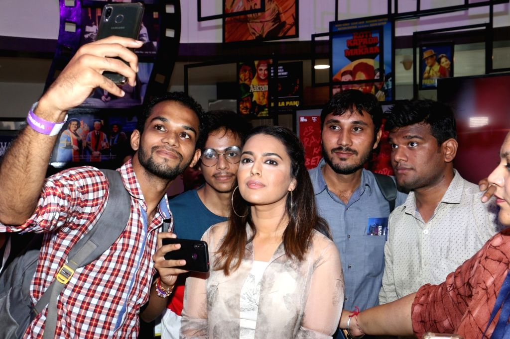 Actress Swara Bhasker poses for selfies with fans during Cinema Festival 2019 organised by Whistling Woods International in Mumbai on Sep 20, 2019. - Swara Bhasker