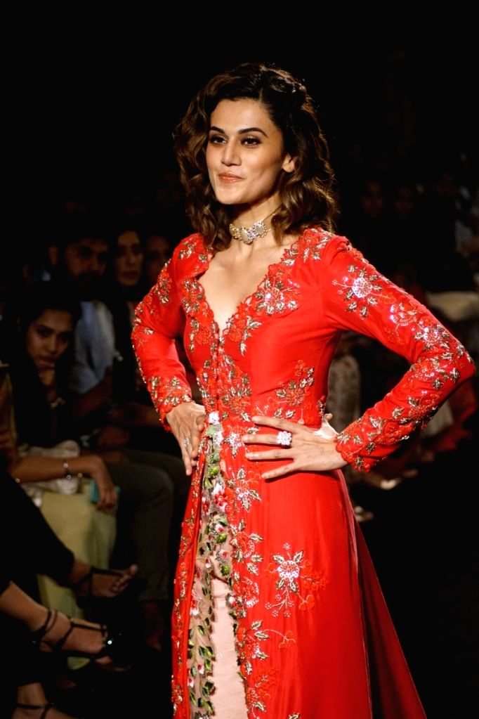 Actress Taapsee Pannu display the creation of fashion designer Divya Reddy during the Lakme Fashion Week Winter/Festive 2017 in Mumbai on Aug 20, 2017. - Taapsee Pannu and Divya Reddy