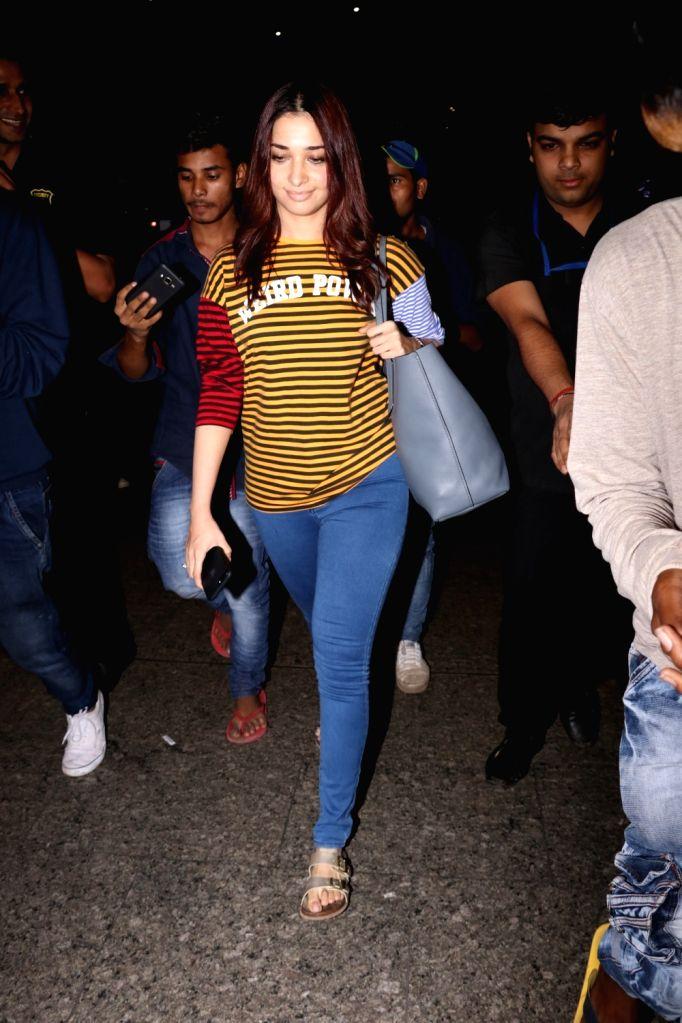 Actress Tamannaah Bhatia spotted at Chhatrapati Shivaji Maharaj International airport in Mumbai on Sept 15, 2017. - Tamannaah Bhatia