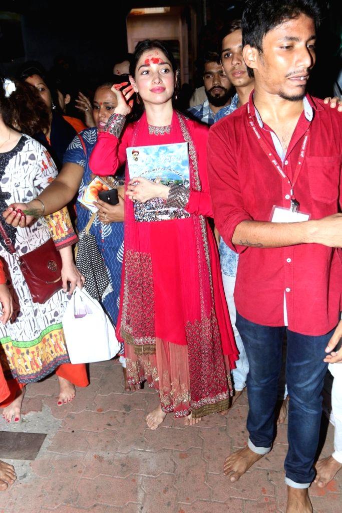 Actress Tamannaah visits Lalbaugcha Raja to offer prayer on the occasion of Ganesh festival in Mumbai, on Sept 11, 2016. - Tamannaah