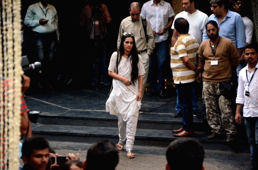 Actress Tara Sharma arrives to attend Late actor Shashi Kapoor's condolence meeting in Mumbai on Dec 7, 2017. - Tara Sharma and Shashi Kapoor
