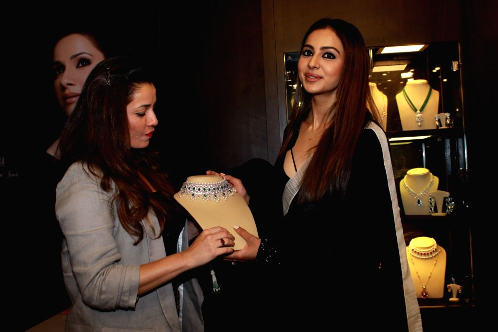 Actress turned jewelry designer Neelam Kothari with actress Rakul Preet Singh at the inauguration of her jewelry store in Mumbai on July 27, 2019. - Rakul Preet Singh