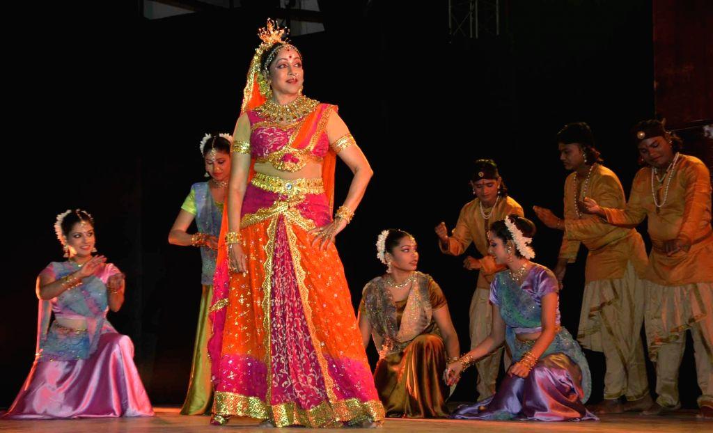 Actress turned politician Hema Malini performs during a programme in Patna on Oct 25, 2016. - Hema Malini