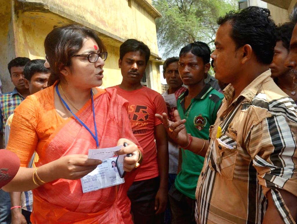 Actress turned politician Locket Chatterjee at a polling booth in Mayureshwar during the third phase of West Bengal Legislative Assembly polls on April 17, 2016. - Chatterjee