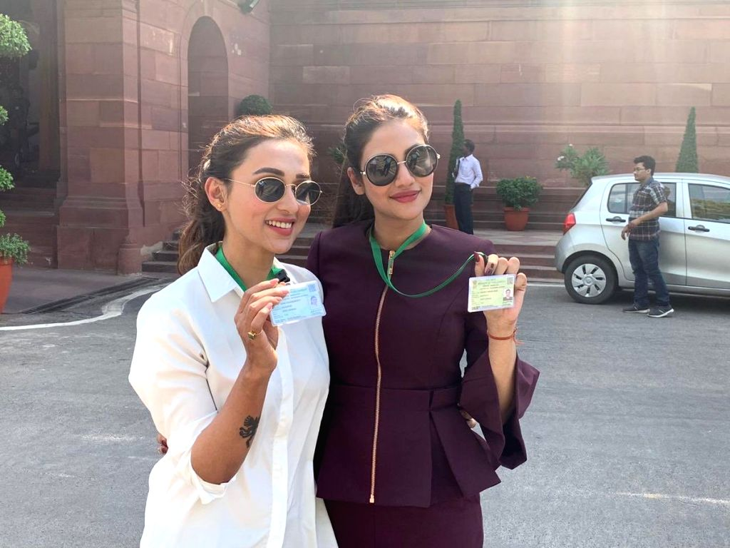 Actress-turned-politicians Mimi Chakraborty and Nusrat Jahan arrive at Parliament for the first time after getting elected in the recently concluded elections from the Trinamool Congress; on May 27, 2019. (Photo: Twitter/@mimichakraborty) - Mimi Chakraborty