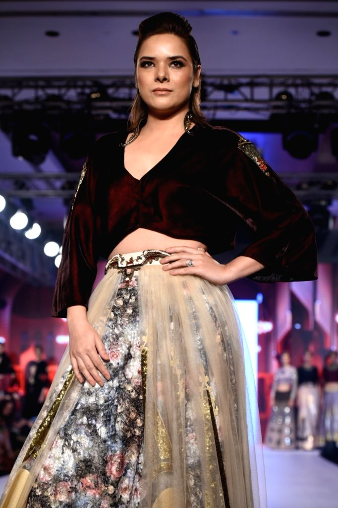 """Actress Udita Goswami displays the creation of fashion designer Rocky S during the """"Bombay Times Fashion Week"""" 2017 in Mumbai. - Udita Goswami"""