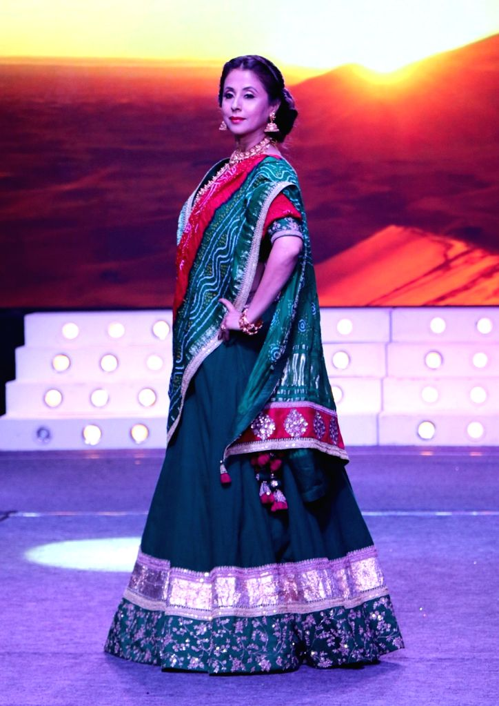 Actress Urmila Matondkar walks the ramp during the launch of a design studio, in Bengaluru on May 26, 2018. - Urmila Matondkar