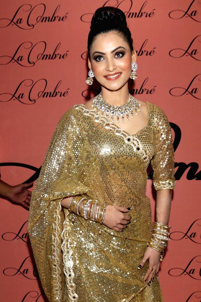 Actress Urvashi Rautela during the pre-launch of Uber-Luxurious Fashion and Lifestyle Exhibition in New Delhi on Aug 23, 2016. - Urvashi Rautela